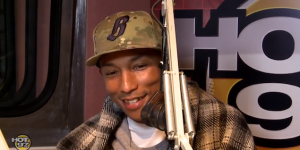 Pharrell-Williams-wears-Billionaire-Boys-Club-Bee-Line-New-Era-59Fifty-fitted-cap-hat-Hermes-plaid-blanket-on-Hot97-Angie-Martinez-Show